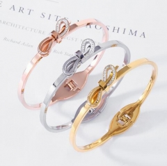 Delicate stereo bow shape stainless steel bangle